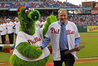 "PHILADELPHIA - AUGUST 2: Former Philadelphia Phillie Curt Schilling is congratulated by the Phillie Phanatic after his induction into the Phillies ""Wall of Fame"" before a game against the Atlanta Braves at Citizens Bank Park on August 2, 2013 in Philadelphia, Pennsylvania. The Braves won 6-4. (Photo by Hunter Martin/Getty Images)"