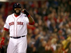 BOSTON, MA - OCTOBER 30: David Ortiz #34 of the Boston Red Sox celebrates after scoring in the third inning against the St. Louis Cardinals during Game Six of the 2013 World Series at Fenway Park on October 30, 2013 in Boston, Massachusetts.  (Photo by Elsa/Getty Images)