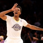 LOS ANGELES, CA - DECEMBER 25:  Nick Young #0 of the Los Angeles Lakers celebrates after making a three point basket against the Miami Heat at Staples Center on December 25, 2013 in Los Angeles, California. The Heat won 101-95.  NOTE TO USER: User expressly acknowledges and agrees that, by downloading and or using this photograph, User is consenting to the terms and conditions of the Getty Images License Agreement.  (Photo by Stephen Dunn/Getty Images)