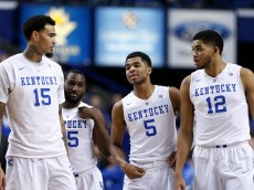 LEXINGTON, KY - JANUARY 20: Karl-Anthony Towns #12, Andrew Harrison #5, Dominique Hawkins #25 and Willie Cauley-Stein #15 of the Kentucky Wildcats look on against the Vanderbilt Commodores during the game at Rupp Arena on January 20, 2015 in Lexington, Kentucky. Kentucky defeated Vanderbilt 65-57. (Photo by Joe Robbins/Getty Images)