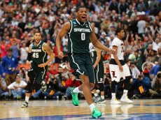 SYRACUSE, NY - MARCH 29:  Marvin Clark Jr. #0 of the Michigan State Spartans celebrates defeating the Louisville Cardinals 76 to 70 in overtime of the East Regional Final of the 2015 NCAA Men's Basketball Tournament at Carrier Dome on March 29, 2015 in Syracuse, New York.  (Photo by Maddie Meyer/Getty Images)