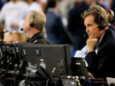 ARLINGTON, TX - APRIL 07: Broadcast personality Jim Nantz looks on during the NCAA Men's Final Four Championship between the Kentucky Wildcats and the Connecticut Huskies at AT&T Stadium on April 7, 2014 in Arlington, Texas.  (Photo by Jamie Squire/Getty Images)
