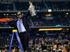 ARLINGTON, TX - APRIL 07:  Head coach Kevin Ollie of the Connecticut Huskies cuts down the net after defeating the Kentucky Wildcats 60-54 in the NCAA Men's Final Four Championship at AT&T Stadium on April 7, 2014 in Arlington, Texas.  (Photo by Jamie Squire/Getty Images)