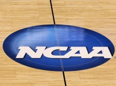 OKLAHOMA CITY - MARCH 20:  A detail of a NCAA logo  decal is seen at center court as the Kansas State Wildcats play against the Brigham Young Cougars during the second round of the 2010 NCAA men's basketball tournament at Ford Center on March 20, 2010 in Oklahoma City, Oklahoma.  (Photo by Ronald Martinez/Getty Images)