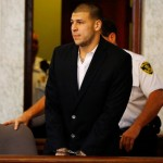 NORTH ATTLEBORO, MA - AUGUST 22: Aaron Hernandez is escorted into the courtroom of the Attleboro District Court for his hearing on August 22, 2013 in North Attleboro, Massachusetts. Former New England Patriot Aaron Hernandez has been indicted on a first-degree murder charge for the death of Odin Lloyd. (Photo by Jared Wickerham/Getty Images)