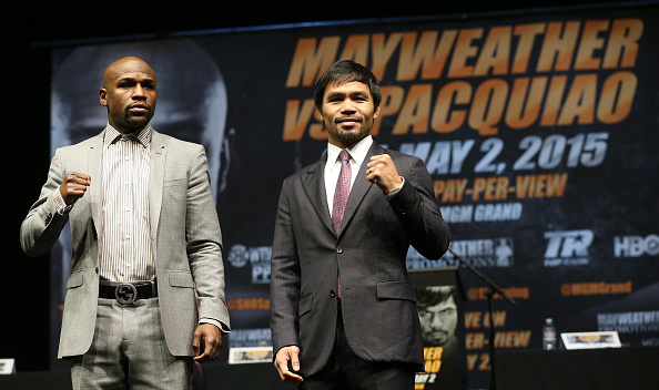 LOS ANGELES, CA - MARCH 11:  Floyd Mayweather (L) and Manny Pacquiao pose together at the end of their Press Conference promoting their upcoming fight on March 11, 2015 in Los Angeles, California.  (Photo by Stephen Dunn/Getty Images)