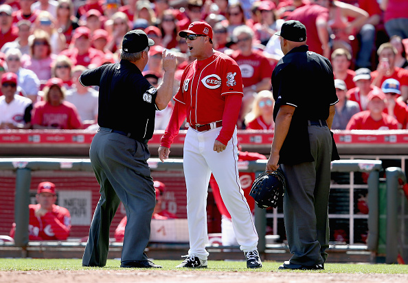 CINCINNATI, OH - APRIL 12:  Bryan Price the Manager of the Cincinnati Reds is ejected by umpire Joe West (left) in the 8th inning during the game against the St. Louis Cardinals at Great American Ball Park on April 12, 2015 in Cincinnati, Ohio.  (Photo by Andy Lyons/Getty Images)