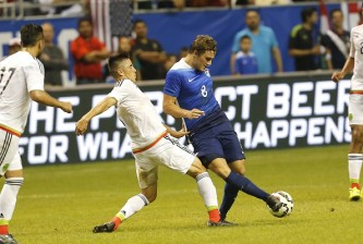 SAN ANTONIO, TX - APRIL 15:  Jordan Morris #8 of the United States kicks the ball away from Efrain Velarde #7 of Mexico during an international friendly match at the Alamodome on April 15, 2015 in San Antonio, Texas.  (Photo by Chris Covatta/Getty Images)