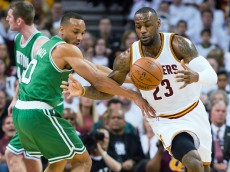 CLEVELAND, OH - APRIL 19: Avery Bradley #0 of the Boston Celtics fights for a loose ball with LeBron James #23 of the Cleveland Cavaliers in the first half during Game One in the Eastern Conference Quarterfinals of the 2015 NBA Playoffs 2015 at Quicken Loans Arena on April 19, 2015 in Cleveland, Ohio. NOTE TO USER: User expressly acknowledges and agrees that, by downloading and or using this photograph, User is consenting to the terms and conditions of the Getty Images License Agreement. (Photo by Jason Miller/Getty Images)