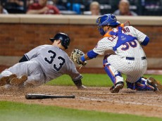 NEW YORK, NY - MAY 15:   Juan Centeno #36 of the New York Mets tags out Kelly Johnson #33 of the New York Yankees at home plate on a Derek Jeter (not pictured) ground ball to shortstop in the eighth inning on May 15, 2014 at Citi Field in the Flushing neighborhood of the Queens borough of New York City.  (Photo by Mike Stobe/Getty Images)