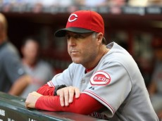 PHOENIX, AZ - MAY 29:  Manager Bryan Price #38 of the Cincinnati Reds watches from the dugout during the MLB game against the Arizona Diamondbacks at Chase Field on May 29, 2014 in Phoenix, Arizona.  (Photo by Christian Petersen/Getty Images)