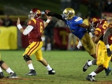 LOS ANGELES, CA - NOVEMBER 30:  Linebacker Anthony Barr #11 of the UCLA Bruins strips the ball  from quarterback Cody Kessler #36 of the USC Trojans for a fumble and a turnover in the fourth quarter at Los Angeles Coliseum on November 30, 2013 in Los Angeles, California.  The Bruins won 35-14.  (Photo by Stephen Dunn/Getty Images)