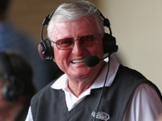 "CHICAGO, IL - AUGUST 06:  Television broadcaster Ken ""Hawk"" Harrelson chats with fans during a break between innings as the Chicago White Sox take on the Texas Rangers at U.S. Cellular Field on August 6, 2014 in Chicago, Illinois. The Rangers defeated the White Sox 3-1.  (Photo by Jonathan Daniel/Getty Images)"