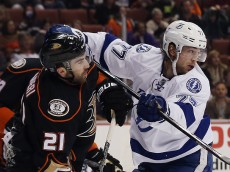 ANAHEIM, CA - FEBRUARY 18: Victor Hedman #77 of the Tampa Bay Lightning gets the stick up on Kyle Palmieri #21 of the Anaheim Ducks during the first period at the Honda Center on February 18, 2015 in Anaheim, California.  (Photo by Bruce Bennett/Getty Images)