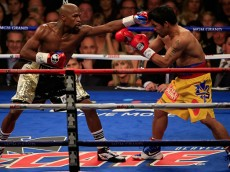 LAS VEGAS, NV - MAY 02:  Floyd Mayweather Jr. throws a left at Manny Pacquiao during their welterweight unification championship bout on May 2, 2015 at MGM Grand Garden Arena in Las Vegas, Nevada.  (Photo by Jamie Squire/Getty Images)