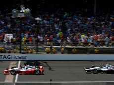 INDIANAPOLIS, IN - MAY 24:  Juan Pablo Montoya of Colombia driver of the #2 Team Penske Chevrolet Dallara crosses the finish line to win the 99th running of the Indianapolis 500 mile race ahead of Will Power of Australia driver of the #12 Team Penskeke Dallara Chevrolet at the Indianapolis Motor Speedway on May 24, 2015 in Indianapolis, Indiana.  (Photo by Robert Laberge/Getty Images)