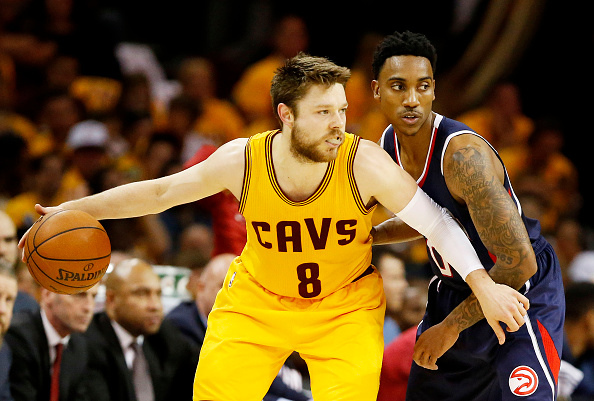 CLEVELAND, OH - MAY 24:  Matthew Dellavedova #8 of the Cleveland Cavaliers drives against Jeff Teague #0 of the Atlanta Hawks in the second quarter during Game Three of the Eastern Conference Finals of the 2015 NBA Playoffs at Quicken Loans Arena on May 24, 2015 in Cleveland, Ohio. NOTE TO USER: User expressly acknowledges and agrees that, by downloading and or using this Photograph, user is consenting to the terms and conditions of the Getty Images License Agreement.  (Photo by Gregory Shamus/Getty Images)