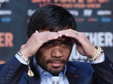 :LAS VEGAS, NV - APRIL 29: WBO welterweight champion Manny Pacquiao looks out at members of the media during a news conference at the KA Theatre at MGM Grand Hotel & Casino on April 29, 2015 in Las Vegas, Nevada. Pacquiao will face WBC/WBA welterweight champion Floyd Mayweather Jr. in a unification bout on May 2, 2015 in Las Vegas. (Photo by Ethan Miller/Getty Images)