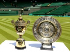 LONDON, ENGLAND - JUNE 21:  The Gentlemen's (left) and Ladies' (right) singles trophies are seen on Centre Court during previews at Wimbledon on June 21, 2014 in London, England.  (Photo by Al Bello/Getty Images)