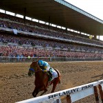 ELMONT, NY - JUNE 06:  American Pharoah #5, ridden by Victor Espinoza, crosses the finish line ahead of Frosted #6, ridden by Joel Rosario, and Keen Ice #7, ridden by Kent Desormeaux, to win the 147th running of the Belmont Stakes at Belmont Park on June 6, 2015 in Elmont, New York.  (Photo by Rob Carr/Getty Images)