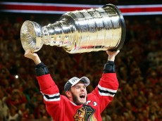 CHICAGO, IL - JUNE 15:  Jonathan Toews #19 of the Chicago Blackhawks celebrates by hoisting the Stanley Cup after defeating the Tampa Bay Lightning  by a score of 2-0 in Game Six to win the 2015 NHL Stanley Cup Final at the United Center  on June 15, 2015 in Chicago, Illinois.  (Photo by Bruce Bennett/Getty Images)