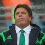 NATAL, BRAZIL - JUNE 13:  Head coach Miguel Herrera of Mexico looks on from the sideline in the first half during the 2014 FIFA World Cup Brazil Group A match between Mexico and Cameroon at Estadio das Dunas on June 13, 2014 in Natal, Brazil.  (Photo by Jamie Squire/Getty Images)