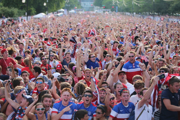 CHICAGO, IL - JUNE 22:  Fans in Grant Park celebrate a goal by the U.S. against Portugal in a Group G World Cup soccer match on June 22, 2014 in Chicago, Illinois. Fans were turned away from the free event after a 10,000-person capacity was reached.  (Photo by Scott Olson/Getty Images)