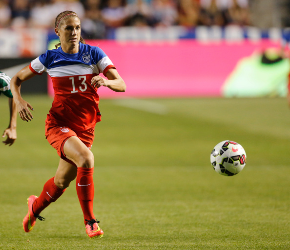 SANDY, UT - SEPTEMBER 13: Alex Morgan #13 of the United States moves the ball down field during a game against Mexico during the first half of an international friendly soccer game September 13, 2014 at Rio Tinto Stadium in Sandy, Utah. The Unites States beat Mexico 8-0. (Photo by George Frey/Getty Images)