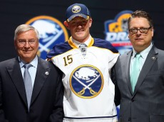 SUNRISE, FL - JUNE 26:  Jack Eichel poses on stage after being selected second overall by the Buffalo Sabres in the first round of the 2015 NHL Draft at BB&T Center on June 26, 2015 in Sunrise, Florida.  (Photo by Bruce Bennett/Getty Images)