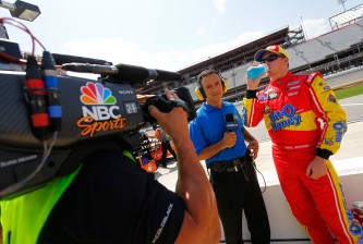 DAYTONA BEACH, FL - JULY 04:  Chris Buescher, driver of the #60 Bit-O-Honey Ford, is interviewed by NBC Sports on the grid during qualifying for the NASCAR XFINITY Series Subway Firecracker 250 at Daytona International Speedway on July 4, 2015 in Daytona Beach, Florida.  (Photo by Brian Lawdermilk/Getty Images)
