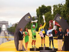 PARIS, FRANCE - JULY 26:  (L-R) Green Jersey winner Peter Sagan of Slovakia and Tinkoff-Saxo, Yellow and Polka Dot Jersey winner Chris Froome of Great Britain and Team Sky and White Jersey winner Nairo Quintana of Colombia and Movistar Team celebrate on the podium following the twenty first stage of the 2015 Tour de France, a 109.5 km stage between Sevres and Paris Champs-Elysees, on July 26, 2015 in Paris, France.  (Photo by Bryn Lennon/Getty Images)