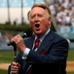 :LOS ANGELES - APRIL 13: Dodgers broadcaster Vin Scully gives the call of 'It's time for Dodger baseball!' during pregame ceremonies for the Los Angeles Dodgers home opener against the San Francisco Giants on April 13, 2009 at Dodger Stadiium in Los Angeles, California. (Photo by Stephen Dunn/Getty Images)