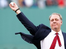 BOSTON, MA - AUGUST 03: Former Boston Red Sox pitcher Curt Schilling #38 throws out the first pitch after being inducted into the Red Sox Hall of Fame prior to the game against the Minnesota Twins during the game on August 3, 2012 at Fenway Park in Boston, Massachusetts. (Photo by Jared Wickerham/Getty Images)