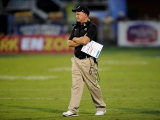 STATESBORO, GA - OCTOBER 11:   Head coach Paul Petrino of the Idaho Vandals waits to talk to his players during a timeout in the second quarter of their game against the Georgia Southern Eagles on October 11, 2014 at Paulson Stadium in Statesboro, Georgia. The Eagles won 47-24.  (Photo by Todd Bennett/GettyImages)