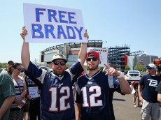 "FOXBORO, MA - MAY 24:  Ryan Desilets and Jon Harmon both from Milford, Massachusetts, show support for New England Patriots quarterback Tom Brady at the ""Free Tom Brady"" rally at Gillette Stadium on May 24, 2015 in Foxboro, Massachusetts. The rally was held in protest of Brady's four game suspension for his role in the ""deflategate"" scandal.  (Photo by Maddie Meyer/Getty Images)"