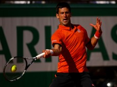 PARIS, FRANCE - JUNE 07:  Novak Djokovic of Serbia returns a shot in the Men's Singles Final against Stanislas Wawrinka of Switzerland on day fifteen of the 2015 French Open at Roland Garros on June 7, 2015 in Paris, France.  (Photo by Dan Istitene/Getty Images)