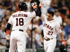 HOUSTON, TX - JUNE 29:  Jose Altuve #27 of the Houston Astros receives congratulations from Luis Valbuena #18 after hitting a home run in the third inning against the Kansas City Royals at Minute Maid Park on June 29, 2015 in Houston, Texas.  (Photo by Bob Levey/Getty Images)