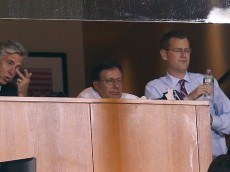 BOSTON, MA - AUGUST 19:  Red Sox executives Sam Kennedy, Tom Werner and Dave Dombrowski  watch a three-run home run by Yan Gomes #10 of the Cleveland Indians in the eighth inning on August 19, 2015 in Boston, Massachusetts.  (Photo by Jim Rogash/Getty Images)