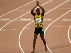 BEIJING, CHINA - AUGUST 27:  Usain Bolt of Jamaica celebrates after crossing the finish line to win gold in the Men's 200 metres final during day six of the 15th IAAF World Athletics Championships Beijing 2015 at Beijing National Stadium on August 27, 2015 in Beijing, China.  (Photo by Lintao Zhang/Getty Images for IAAF)