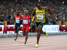BEIJING, CHINA - AUGUST 29:  Usain Bolt of Jamaica crosses the finish line to win gold in the Men's 4x100 Metres Relay final during day eight of the 15th IAAF World Athletics Championships Beijing 2015 at Beijing National Stadium on August 29, 2015 in Beijing, China.  (Photo by Cameron Spencer/Getty Images)
