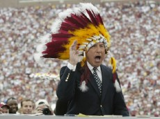 TALLAHASSEE, FL - OCTOBER 26:  ESPN College GameDay announcer Lee Corso dons an FSU headress as co-announcers (l to r) Chris Fowler and Kirk Herbstreit comment during the NCAA football game between Notre Dame and Florida State at Doak Campbell Stadium on October 26, 2002 in Tallahassee, Florida.  The Notre Dame Fighting Irish defeated the Florida State Seminoles 34-24.  (Photo by Craig Jones/Getty Images)