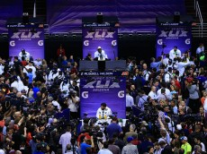 PHOENIX, AZ - JANUARY 27:  Russell Wilson #3 of the Seattle Seahawks addresses the media at Super Bowl XLIX Media Day Fueled by Gatorade inside U.S. Airways Center on January 27, 2015 in Phoenix, Arizona.  (Photo by Rob Carr/Getty Images)