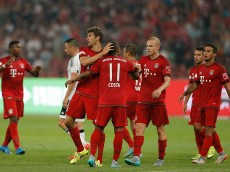 BEIJING, CHINA - JULY 18:  Thomas Mueller (C) of FC Bayern Muenchen celebrates with teammates after scoring his second goal during the international friendly match between FC Bayern Muenchen and Valencia FC during the Audi Football Summit Beijing 2015 at National Stadium on July 18, 2015 in Beijing, China.  (Photo by Lintao Zhang/Getty Images)