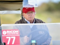 AYR, SCOTLAND - JULY 30:  Republican Presidential Candidate Donald Trump drives a golf buggy during his visits to his Scottish golf course Turnberry on July 30, 2015 in Ayr, Scotland. Donald Trump answered questions from the media at a press conference held in his hotel.  (Photo by Jeff J Mitchell/Getty Images)