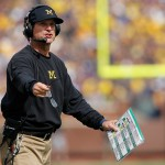 ANN ARBOR, MI - SEPTEMBER 26:  Head coach Jim Harbaugh of the Michigan Wolverines leads his team against the Brigham Young Cougars at Michigan Stadium on September 26, 2015 in Ann Arbor, Michigan. The Wolverines defeated the Cougars 31-0.  (Photo by Doug Pensinger/Getty Images)