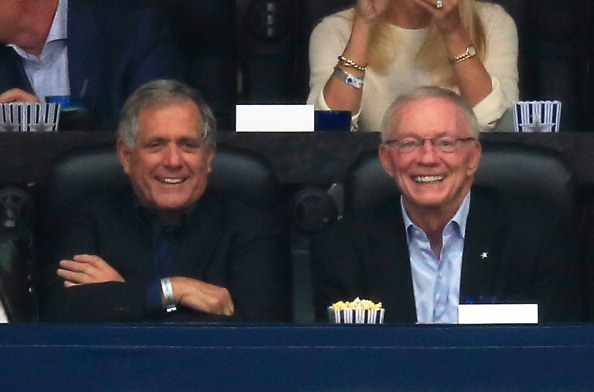ARLINGTON, TX - APRIL 05: Chairman and CEO of CBS Les Moonves (L) and Dallas Cowboys owner Jerry Jones look on during the NCAA Men's Final Four Semifinal at AT&T Stadium between the Florida Gators and the Connecticut Huskies on April 5, 2014 in Arlington, Texas.  (Photo by Jamie Squire/Getty Images)