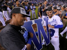KANSAS CITY, MO - SEPTEMBER 24:  Salvador Perez #13 and Eric Hosmer #35 of the Kansas City Royals celebrate after clinching the American League Central Division title at Kauffman Stadium on September 24, 2015 in Kansas City, Missouri. (Photo by Ed Zurga/Getty Images)