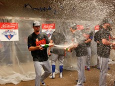 CINCINNATI, OH - SEPTEMBER 27: Members of the New York Mets celebrate with champagne in the clubhouse after defeating the Cincinnati Reds 10-2 to clinch the National League East Championship at Great American Ball Park on September 26, 2015 in Cincinnati, Ohio.  (Photo by John Sommers II/Getty Images)