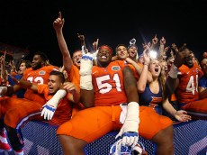GAINESVILLE, FL - OCTOBER 03: Antonio Riles #51 of the Florida Gators celebrates in the stands with fans after defeating the Mississippi Rebels in the game on October 3, 2015 in Gainesville, Florida.  (Photo by Rob Foldy/Getty Images)