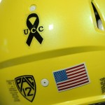 BOULDER, CO - OCTOBER 03:  The Oregon Ducks wear a black ribbon on their helmets honoring the victims of the shooting at Umpqua Community College in Roseburg, Oregon as they face the Colorado Buffaloes at Folsom Field on October 3, 2015 in Boulder, Colorado.  (Photo by Doug Pensinger/Getty Images)